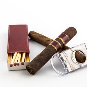 bigstock-Cigar-With-Matches-And-Cutter-58989464-1024x1024